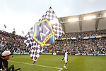 01 December 2012: Los Angeles' Juninho (BRA) races around the field with a large flag after the game. The Los Angeles Galaxy played the Houston Dynamo at the Home Depot Center in Carson, California in MLS Cup 2012. Los Angeles won the game 3-1.