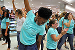 "End of Flash Mob event for Estee Lauder at Macy's in Long Island, New York, USA, on July 23, 2011. Teal shirts dancers wearing have ""Imagine having nothing to hide"" written on front."
