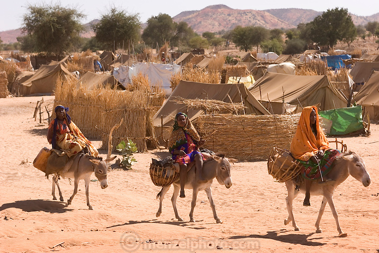 Women ride donkeys inside the Breidjing Refugee Camp in Eastern Chad. The camp, located near the Sudanese border shelters 30,000 people who have fled their homes in Darfur, Sudan.