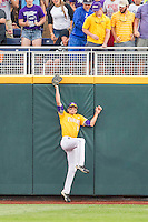 LSU Tigers outfielder Mark Laird (9) makes a jumping catch against the wall against the TCU Horned Frogs in Game 10 of the NCAA College World Series on June 18, 2015 at TD Ameritrade Park in Omaha, Nebraska. TCU defeated the Tigers 8-4, eliminating LSU from the tournament. (Andrew Woolley/Four Seam Images)