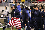 20 March 2008: Sacha Kljestan (USA) (holding flag) and teammate celebrate after the game. The United States U-23 Men's National Team defeated the Canada U-23 Men's National Team 3-0 at LP Field in Nashville,TN in a semifinal game during the 2008 CONCACAF Men's Olympic Qualifying Tournament. With the victory, the United States qualified for the 2008 Beijing Olympics.