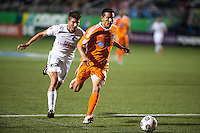 HEMPSTEAD, NY – OCTOBER 12: Stefan Dimitrov of the New York Cosmos and Kapuno Low of the Carolina RailHawks fight for the ball during an NASL match on October 12, 2013 at  Shuart Stadium in Hempstead, New York.