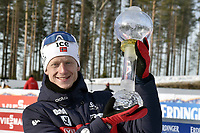 March 14th 2020, Kontiolahti, Finland;  Johannes Thingnes Boe of Norway celebrates with the trophy for the overall victory in the seasons World Cup after the mens 12.5 km Pursuit competition at the IBU Biathlon World Cup in Kontiolahti, Finland, on March 14, 2020.