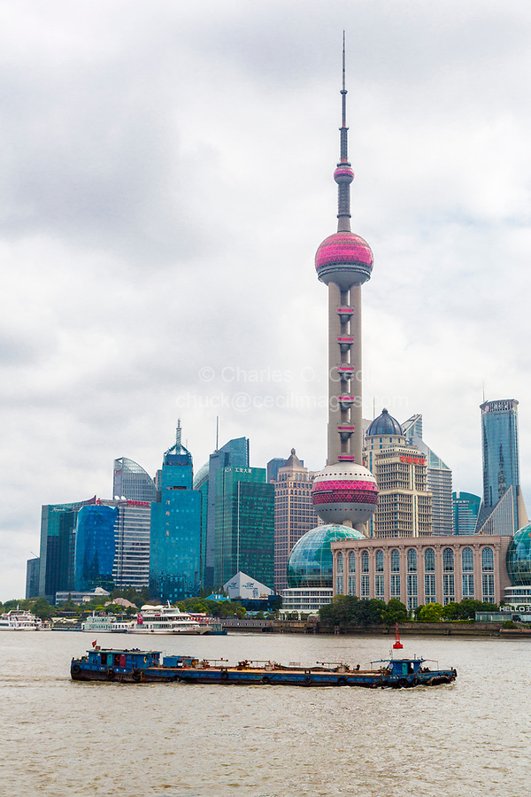 China, Shanghai.  Oriental Pearl Television Tower, Pudong District, across the River Huangpu.