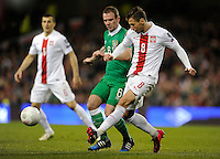 29th March 2015; UEFA EURO 2016 Championship Qualifier Group D, Ireland vs Poland, Aviva Stadium, Dublin<br /> Poland's Grzegorz Krychowiak with Glenn Whelan of Republic of Ireland.<br /> Picture credit: Tommy Grealy/actionshots.ie.