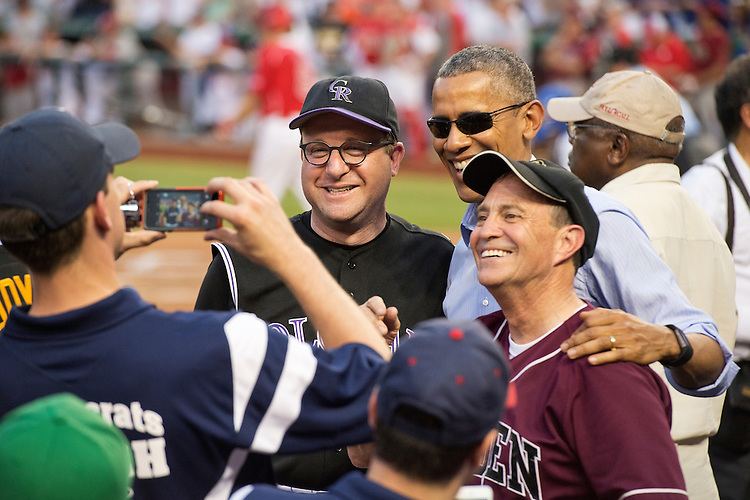 UNITED STATES - JUNE 11: President Barack Obama talks with Reps. Jared Polis, D-Colo., left, and Ed Perlmutter, D-Colo., during the 54th Congressional Baseball Game in Nationals Park, June 11, 2015. The Democrats prevailed over the Republicans 5-2. (Photo By Tom Williams/CQ Roll Call)