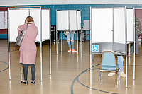 People vote in the Massachusetts Primary at the Holy Name Parish Hall polling place on Super Tuesday in West Roxbury, Massachusetts, on Tue., March 3, 2020.
