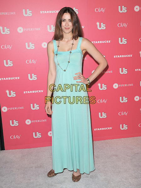 MADELINE ZIMA .at US Weekly Hot Hollywood Style Issue Party held at Eden in Hollywood, California, USA, April 26th 2011.full length hand on hip long maxi sleeveless dress green necklace .CAP/RKE/DVS.©DVS/RockinExposures/Capital Pictures.