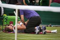 27-06-13, England, London,  AELTC, Wimbledon, Tennis, Wimbledon 2013, Day four, Simona Halep (ROU) gets a medicate treatment<br /> <br /> <br /> <br /> Photo: Henk Koster