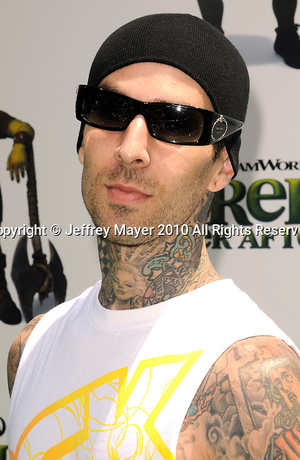 "UNIVERSAL CITY, CA. - May 16: Travis Barker arrives at the ""Shrek Forever After"" Los Angeles Premiere at Gibson Amphitheatre on May 16, 2010 in Universal City, California."