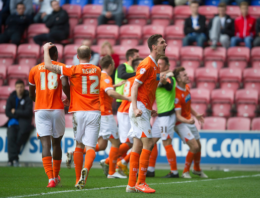 Blackpool's Chris Basham celebrates team-mate Andy Keogh's opening goal in front of the traveling fans<br /> Photo by Stephen White/CameraSport<br /> <br /> Football - The Football League Sky Bet Championship - Wigan Athletic v Blackpool - Saturday 26th April 2014 - DW stadium - Wigan<br /> <br /> &copy; CameraSport - 43 Linden Ave. Countesthorpe. Leicester. England. LE8 5PG - Tel: +44 (0) 116 277 4147 - admin@camerasport.com - www.camerasport.com