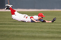 Max White (7) dives for the catch in left field during the NCAA matchup between the University of Arkansas-Little Rock Trojans and the University of Oklahoma Sooners at L. Dale Mitchell Park in Norman, Oklahoma; March 11th, 2011.  Oklahoma won 11-3.  Photo by William Purnell/Four Seam Images
