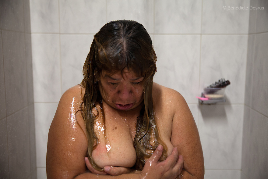 Soledad, a resident of Casa Xochiquetzal, takes a shower at the shelter in Mexico City, Mexico on September 3, 2013. Casa Xochiquetzal is a shelter for elderly sex workers in Mexico City. It gives the women refuge, food, health services, a space to learn about their human rights and courses to help them rediscover their self-confidence and deal with traumatic aspects of their lives. Casa Xochiquetzal provides a space to age with dignity for a group of vulnerable women who are often invisible to society at large. It is the only such shelter existing in Latin America. Photo by Bénédicte Desrus