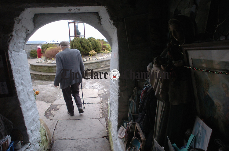 """The Grotto visited, an elderly man begins the """"rounds"""" at St Brigids Well, Liscannor on the feast day of St Brigid. Photograph by John Kelly."""