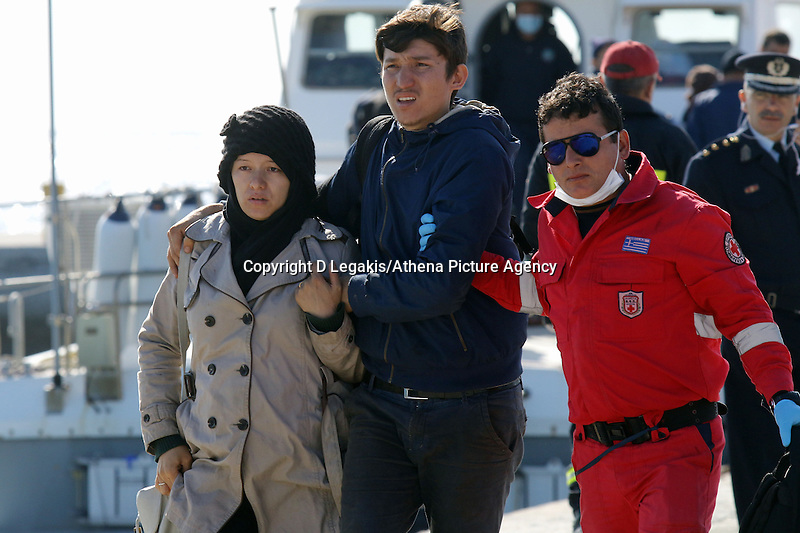 Pictured: A young couple are helped to safety by a member of the emergency services Thursday 27 November 2014<br /> Re: One of the largest refugee boats in recent months has disembarked refugees in Ierapetra, Crete. The freighter Baris, carrying 700 people thought to be from Syria and Afghanistan, is being towed by a Greek frigate.<br /> Officials and Red Cross volunteers prepared an indoor basketball stadium as interim shelter in the southern Cretan port town of Ierapetra on Wednesday ahead of the migrants' expected arrival.<br /> Greek officials said the Baris, which lost propulsion on Tuesday, was being towed slowly in poor sea conditions and would arrive after nightfall, probably early Thursday.<br /> They said it was unclear which Mediterranean location had been the departure point for the 77-meter (254-foot) vessel, which was sailing under the flag of the Pacific nation of Kiribati.