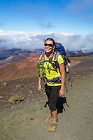 A backpacker on the Sliding Sands Trail at Haleakala National Park, Maui.