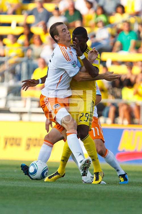 24 JULY 2010:  Cam Weaver of the Houston Dynamo (15) and Shaun Francis of the Columbus Crew (29) during MLS soccer game between Houston Dynamo vs Columbus Crew at Crew Stadium in Columbus, Ohio on July 3, 2010. Columbus defeated the Dynamo 3-0.