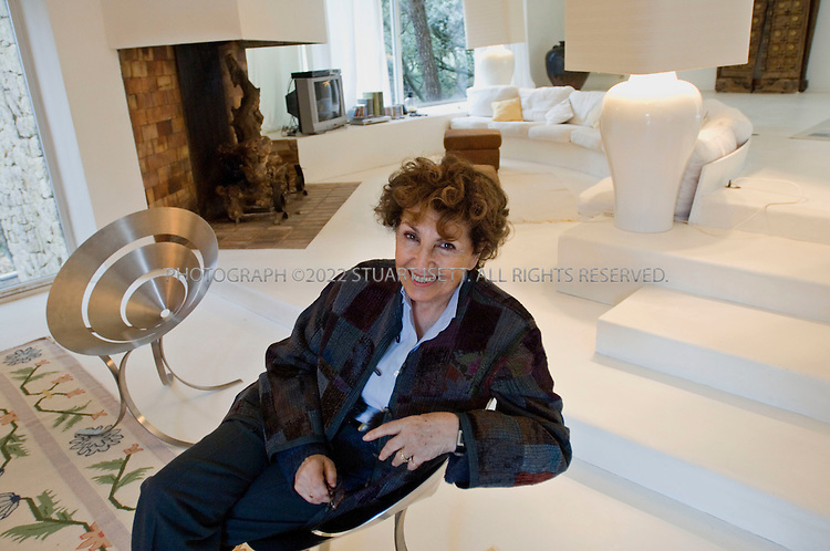 3/11/2006--St. Pierre de Vassols, France..Designer Maria Pergay sitting on one of her chair designs in the living room of her summer home of  just outside Avignon in the south of France. Pergay was born in Moldavie, Russia in 1930 and emigrated to Paris in 1937. Over Pergay?s 50-plus-year career, her objects, furniture and decor have brought her a following that included Salvador Dali, Pierre Cardin and King Fahd of Saudi Arabia, but her work has only recently gained recognition among design collectors, curators and aficionados...Photograph By Stuart Isett.All photographs ©2006 Stuart Isett.All rights reserved.