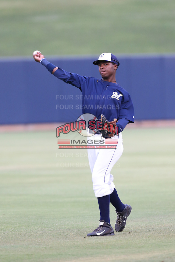 Yerald Martinez (27) of the AZL Brewers throws before a game against the AZL Athletics at Maryvale Baseball Park on June 30, 2015 in Phoenix, Arizona. Brewers defeated Athletics, 4-2. (Larry Goren/Four Seam Images)