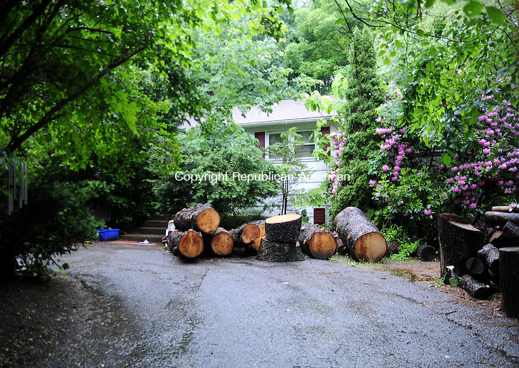 PLYMOUTH, CT, 07 JUNE 13- 060413AJ01-  The property at 4 Chidsey Terrace a year ago was not passable. Now, although there are piles of wood and junk remaining, the house can be accessed by emergency vehicles, officials said.   ALEC JOHNSON/ REPUBLICAN-AMERICAN