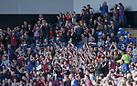The travelling fans from Arbroath celebrating their goal