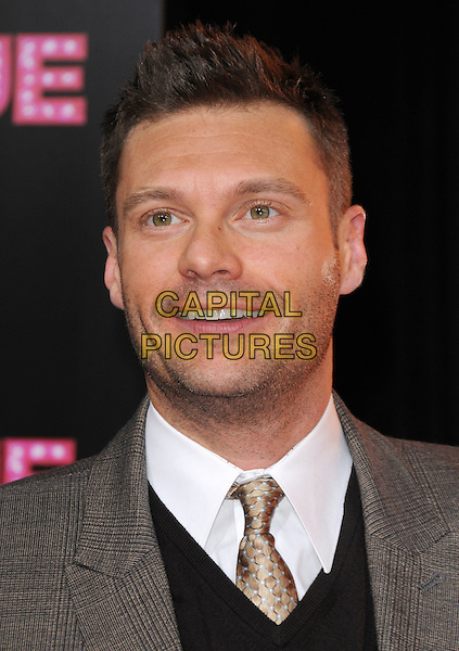 RYAN SEACREST.'Burlesque' Los Angeles Premiere held at The Grauman Chinese Theatre, Hollywood, CA, USA. .November 15th, 2010 .headshot portrait smiling tie grey gray white shirt black tweed plaid checked check stubble facial hair .CAP/RKE/DVS.©DVS/RockinExposures/Capital Pictures.