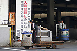 Men drive turret trucks at Tokyo's Tsukiji Wholesale Fish Market on October 10, 2018, Tokyo, Japan. Tokyo's iconic fish market closed its doors for the last time on October 6 for a move to a newly created facility, ''The Toyosu Fish Market,'' which will start operating on October 16. The wholesale fish market in Tsukiji first opened in the mid-1930s and was one of the Japanese capital's most popular destinations for international tourists. (Photo by Rodrigo Reyes Marin/AFLO)