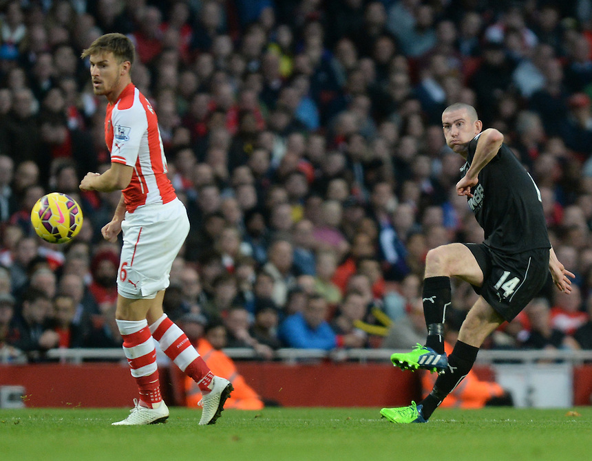 Burnley's David Jones whips the ball into the box <br /> <br /> Photographer Ian Cook/CameraSport<br /> <br /> Football - Barclays Premiership - Arsenal v Burnley - Saturday 1st November 2014 - Emirates Stadium - London<br /> <br /> &copy; CameraSport - 43 Linden Ave. Countesthorpe. Leicester. England. LE8 5PG - Tel: +44 (0) 116 277 4147 - admin@camerasport.com - www.camerasport.com