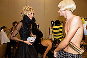 September 17, 2010.  Raleigh, North Carolina..Brooke Holland and Joshua Price make some finishing touches before hitting the runway at fashionSpark 2010.  Outfits were made courtesy of Zach Schell Designs.