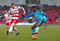 Jordy Hiwula of Fleetwood Town wins the ball against Tom Anderson of Doncaster Rovers during the Sky Bet League 1 match between Doncaster Rovers and Fleetwood Town at the Keepmoat Stadium, Doncaster, England on 17 February 2018. Photo by Leila Coker / PRiME Media Images.