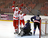 Ben Osborne (arm raised) celebrates after scoring Haringey's second goal during the National Ice Hockey League South Division 2 Cup - Group B game between Haringey Racers and Slough Jets at Alexandra Palace, London on Sat Sept 13, 2014.