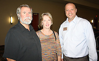 NWA Democrat-Gazette/CARIN SCHOPPMEYER Tom and Ruth Ann Hough (from left) and Jason Barta gather at Sip and Savor.