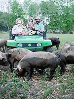 Jeremiah Jones and his family (wife Jessica and daughters Marty and Kate) at Beaulaville, NC pig farm - Grassroots Pork Co.