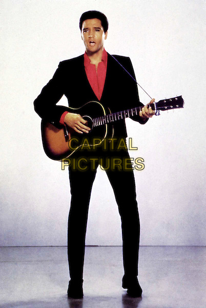 ELVIS PRESLEY .mid 1960s.Editorial Use Only.Ref: FB.full length, full-length, playing guitar, music.sales@capitalpictures.com.www.capitalpictures.com.Supplied by Capital Pictures.