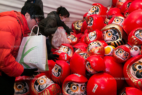 Visitors return their Daruma dolls to be burned later at the Shorinzan Daruma Temple in Takasaki City, Gunma Prefecture on January 6, 2016, Japan. Every year thousands of people visit the country's most famous Daruma market (Daruma ichi) held at the Shorinzan Daruma Temple on January 6 and 7. Takasaki City, is known as the capital of Daruma dolls and about 80% of Japan's Daruma are produced there. According to the tradition, Daruma dolls are sold without pupils painted on their eyes. People color in one pupil when a wish is made or a goal set, and when the wish comes true or the goal is achieved they fill in the other pupil. At the end of the year, used Daruma dolls are returned to the temple to be burned. (Photo by Rodrigo Reyes Marin/AFLO)