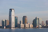 The Goldman Sachs Tower and Colgate-Palmolive clock along with other buildings of the Jersey City, New Jersey, skyline overlooking the Hudson River.