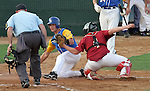 SIOUX FALLS, SD - MAY 26:  Alex Linneman #16 from O'Gorman is tagged out at home by catcher Kenny Dobberpuhl #4 from Roosevelt while home plate umpire Lloyd Jones Jr. makes the call in the third inning during the Class A Championship Game Saturday night at the Sioux Falls Stadium. (Photo by Dave Eggen/Inertia)