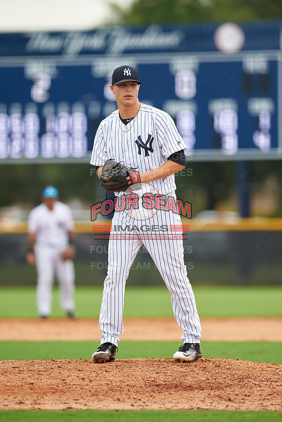 GCL Yankees East relief pitcher Janson Junk (23) gets ready to deliver a pitch during the first game of a doubleheader against the GCL Yankees West on July 19, 2017 at the Yankees Minor League Complex in Tampa, Florida.  GCL Yankees West defeated the GCL Yankees East 11-2.  (Mike Janes/Four Seam Images)