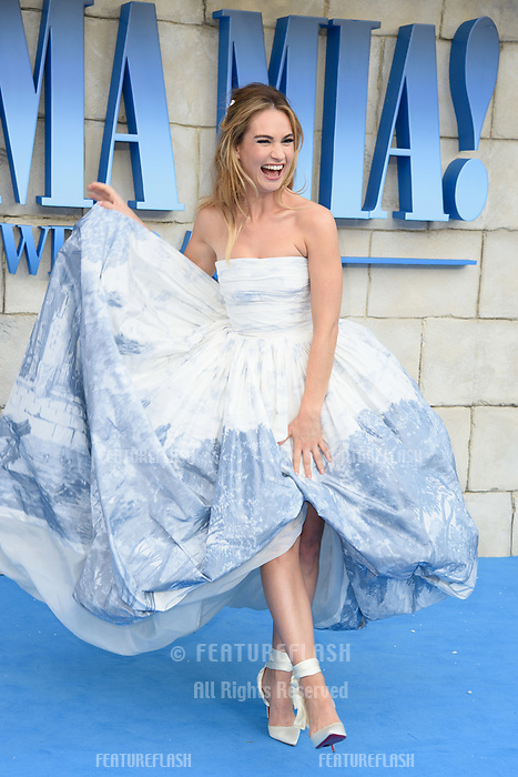 Lily James arriving for the &quot;Mama Mia! Here We Go Again&quot; world premiere at the Eventim Apollo, Hammersmith, London, UK. <br /> 16 July  2018<br /> Picture: Steve Vas/Featureflash/SilverHub 0208 004 5359 sales@silverhubmedia.com