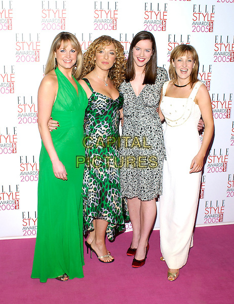 KIM MEDCALF, TRACEY ANN OBERBAN, MICHELLE RYAN & KACEY AINSWORTH.Elle Style Awards 2005.Spitalfields Market.London 15 February 2005.Ref: PL.full length, Tracy, green dress white dress arm around waist.www.capitalpictures.com.sales@capitalpictures.com.©Capital Pictures.