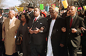 Reverend Al Sharpton, center, leads a demonstration outside the Justice Department in Washington Thursday, March 2, 2000, to protest the verdict in the Amadou Diallo murder trial. From left are, former New York City Mayor David Dinkins; Jackie Jackson, wife of Reverend Jesse Jackson; Sharpton; Saikou Diallo, Amadou Diallo's father; and NAACP President Kweisi Mfume. .Credit: Ron Sachs / CNP