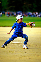 "JP0976 ""Aron Catches The Ball - Six year old playing little league baseball"