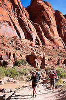 Hikers walk through the Paria River Canyon in northern Arizona.