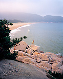 CHINA, Putou Shan, an elevated view of monk standing on a rock in front of Thousand Steps Beach