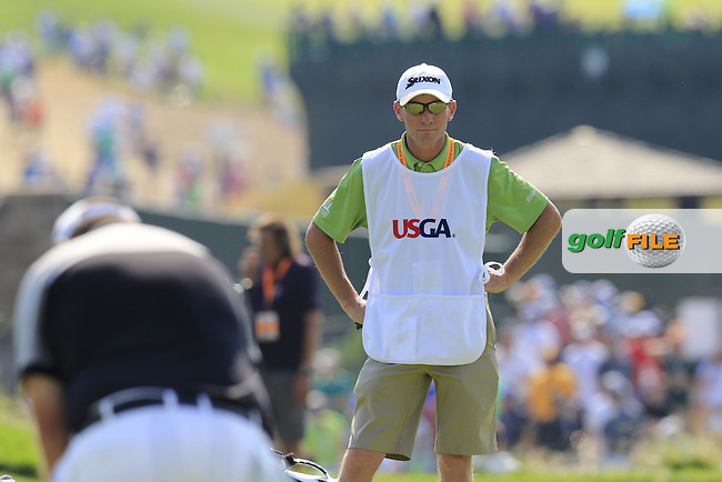 Dermot Byrne caddy for Shane Lowry (IRL) on the 4th green during Sunday's Final Round of the 2016 U.S. Open Championship held at Oakmont Country Club, Oakmont, Pittsburgh, Pennsylvania, United States of America. 19th June 2016.<br /> Picture: Eoin Clarke | Golffile<br /> <br /> <br /> All photos usage must carry mandatory copyright credit (&copy; Golffile | Eoin Clarke)