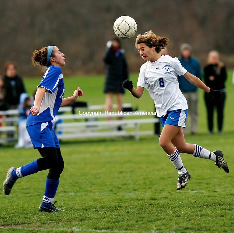 Woodbury, CT-11 November 2009-111109CM01--    Nonnewaug's Sidney Spremullo heads the ball while East Catholic's Mary Casey defends Wednesday afternoon in Woodbury.      <br /> Christopher Massa Republican-American