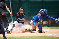 GCL Braves second baseman Luis Ovando (25) slides home safely as catcher Manuel Herazo (9) waits for a throw during a game against the GCL Blue Jays on August 5, 2016 at ESPN Wide World of Sports in Orlando, Florida.  GCL Braves defeated the GCL Blue Jays 9-0.  (Mike Janes/Four Seam Images)