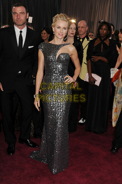 Liev Schreiber & Naomi Watts (wearing Armani Prive).85th Annual Academy Awards held at the Dolby Theatre at Hollywood & Highland Center, Hollywood, California, USA..February 24th, 2013.oscars full length gunmetal grey gray sequins asymmetrical sequined liquid glittering gown with cutout neckline stubble facial hair hand on hip dress metallic black suit couple .CAP/ROT/TM.©Tony Michaels/Roth Stock/Capital Pictures