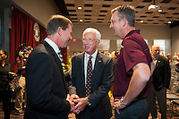 Mississippi State University Bulldog Club Board President Mickey Holliman (center) and Gentry Long (right) greet John Cohen, who was introduced as the university's 17th director of athletics Friday [Nov. 4] during a press conference at The Mill at MSU.<br />