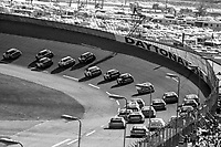 A pack of cars races into turn one, Daytona 500, NASCAR Winston Cup race, Daytona International Speedway, Daytona Beach, FL, February 1994(Photo by Brian Cleary/bcpix.com)